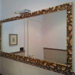 cornice dorata specchio
